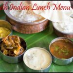 South Indian Lunch Menu 24 – Paruppu Urundai Mor Kuzhambu, Kalyana Rasam, Bittergourd Stir-Fry, Dal with ghee, Curd and Papad